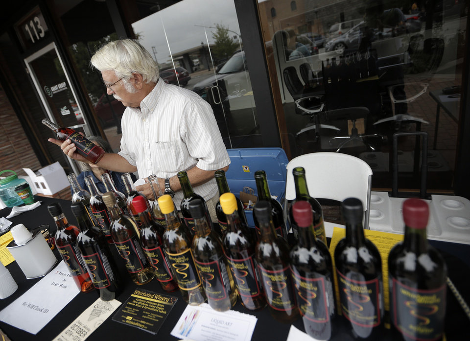 Photo - Don Molnar, of Whirlwind Winery in Watonga, hands out samples during the Downtown Edmond Fall Art Crawl in Edmond, Okla., Saturday, Sept. 29, 2012.  Photo by Garett Fisbeck, The Oklahoman