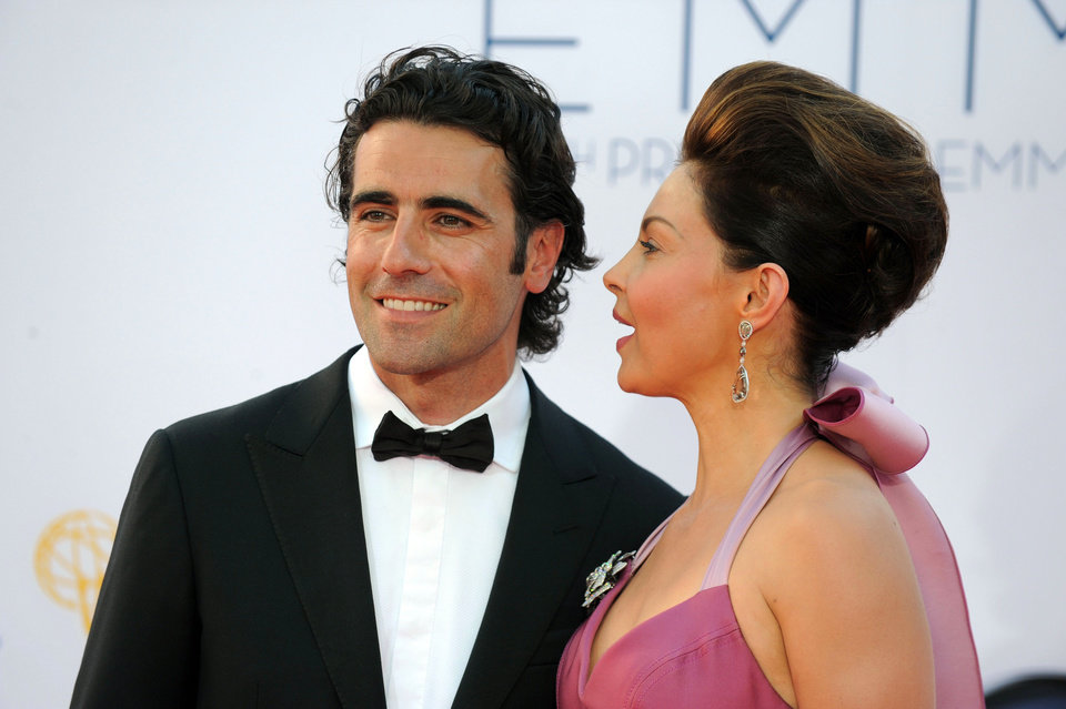 Photo -   Actress Ashley Judd, right and husband Dario Franchitti arrives at the 64th Primetime Emmy Awards at the Nokia Theatre on Sunday, Sept. 23, 2012, in Los Angeles. (Photo by Matt Sayles/Invision/AP)