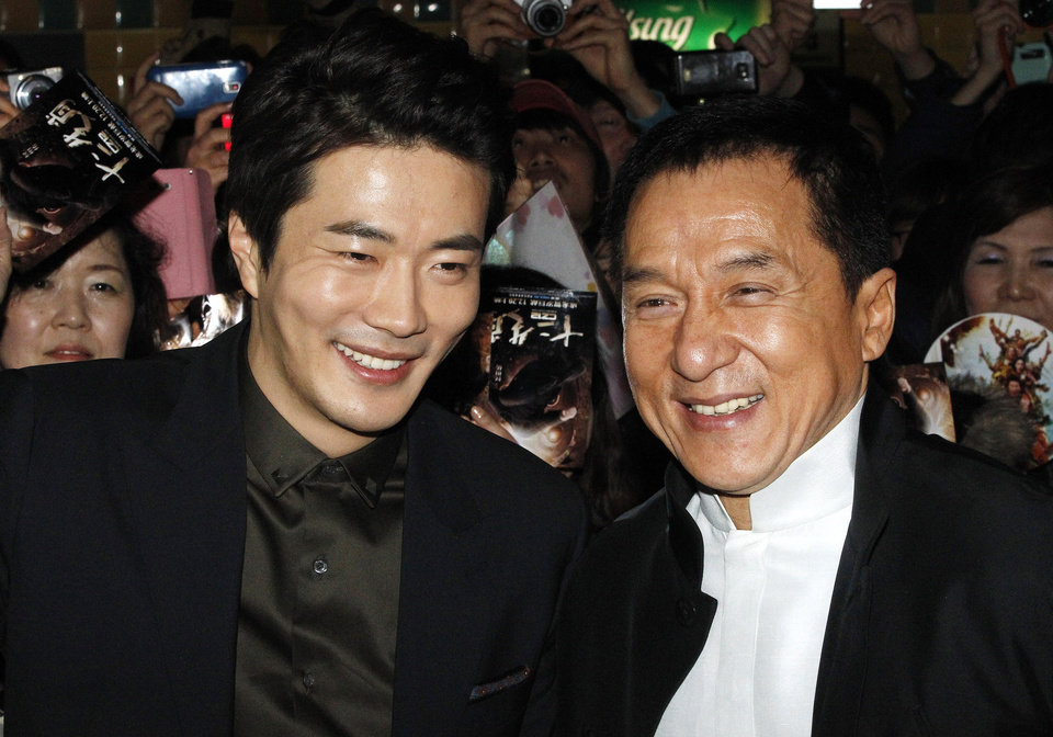 Photo - CORRECTS YEAR - Hong Kong actor and director Jackie Chan, right, and South Korean actor Kwon Sang-woo smile during a promotional event for their latest movie, CZ12, or Chinese Zodiac, in Seoul, South Korea, Monday, Feb. 18, 2013.(AP Photo/Ahn Young-joon)