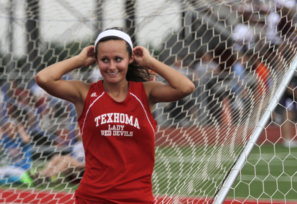 Photo - HIGH SCHOOL TRACK AND FIELD: Ann Freeman, of Texhoma High School, smiles after winning the girls Class A high jump during a track meet at Carl Albert High School in Midwest City, Friday, May 4, 2012.  Photo by Garett Fisbeck, For The Oklahoman