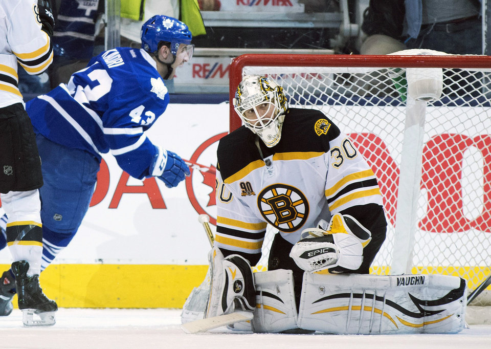 Photo - Boston Bruins goaltender Chad Johnson reacts as Toronto Maple Leafs center Nazem Kadri celebrates his game winning overtime goal in an NHL hockey game in Toronto on Thursday, April 3, 2014. (AP Photo/The Canadian Press, Frank Gunn)