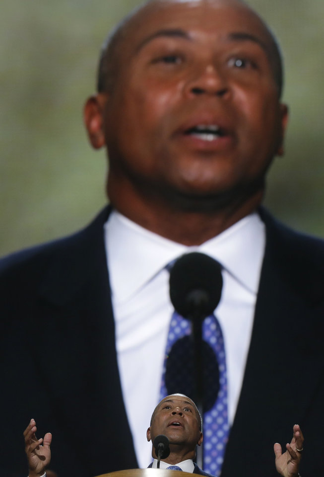Photo - Massachusetts Gov. Deval Patrick addresses the Democratic National Convention in Charlotte, N.C., on Tuesday, Sept. 4, 2012. (AP Photo/Charles Dharapak)  ORG XMIT: DNC786