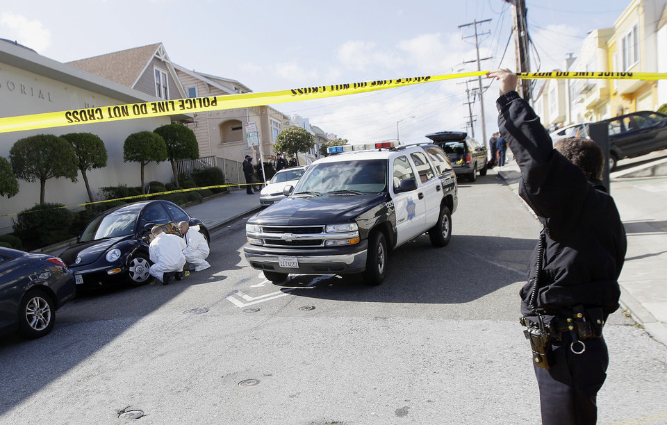 Photo -   San Francisco Police officers inspect outside of a home on Howth Street in San Francisco, Friday, March 23, 2012. Five members of a family were found dead inside a home near San Francisco's City College in an apparent murder-suicide, police said Friday. (AP Photo/Jeff Chiu)