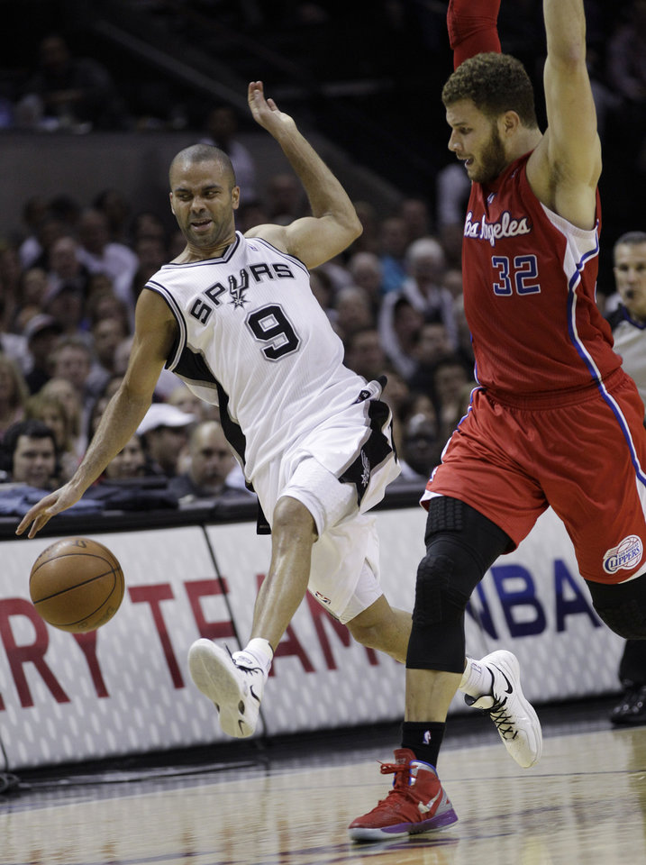 Photo -   San Antonio Spurs' Tony Parker (9), of France, is fouled by Los Angeles Clippers' Blake Griffin (32) while moving the ball upcourt during the second quarter of Game 2 of an NBA basketball Western Conference semifinal playoff series on Thursday, May 17, 2012, in San Antonio. (AP Photo/Eric Gay)