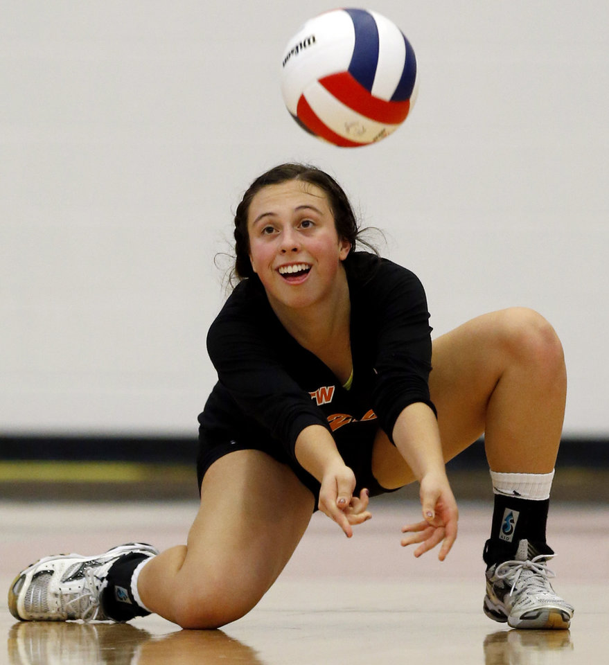 Booker T. Washington\'s Jane Eagleton returns a ball against Shawnee during the Class 5A State Championship volleyball tournament on Friday, Oct. 12, 2012, in Moore, Okla. Photo by Steve Sisney, The Oklahoman