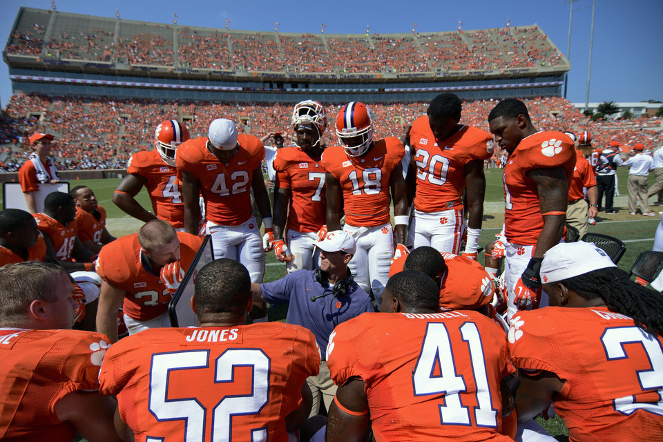 Photo -   CLEMSON     * Coach:  Dabo Swinney    * 2013 model:  Orange Bowl win made up for discouraging defeats to Florida State and South Carolina    * Strengths:  Pressure and pass rush — Brent Venables' unit produced 30 turnovers last season   * Weaknesses:  How do you replace Tajh Boyd and Sammy Watkins?    * Key dates: Aug. 30 at Georgia, Sept. 20 at Florida State, Nov. 29 at home vs. South Carolina    * Outlook:  Two early road tests will determine Tigers' fate         PHOTO BY THE ASSOCIATED PRESS