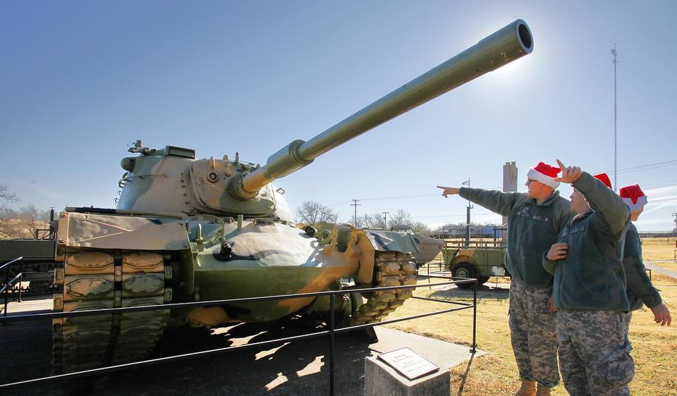 New recruit look over a tank on displays at the 45th Infantry Museum during Soldiers Day Out, Friday, December 21, 2012. Edmond/North OKC Blue Star Mothers will be taking the soldiers who can't go home for Christmas around the metro for a day of fun. Photo By David McDaniel/The Oklahoman