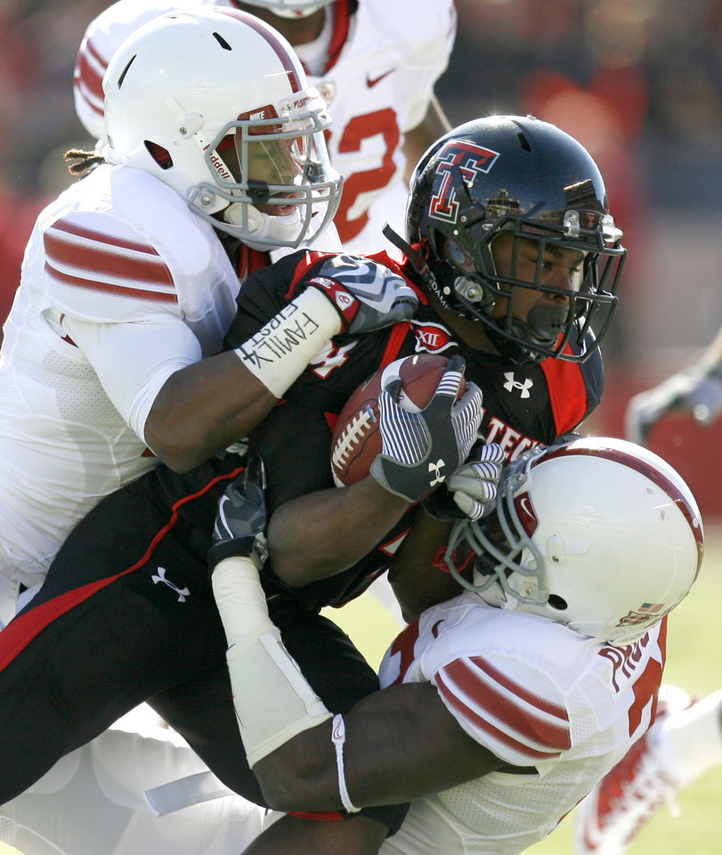 Photo - OU's Marcus Trice, left, and Sam Proctor bring down Texas Tech's Eric Stephens during the college football game between the University of Oklahoma Sooners (OU) and Texas Tech University Red Raiders (TTU ) at Jones AT&T Stadium in Lubbock, Texas, Saturday, Nov. 21, 2009. Photo by Bryan Terry, The Oklahoman