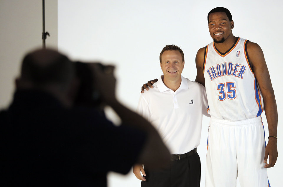 Photo - Coach Scott Brooks and Kevin Durant pose for photos during media day with the Oklahoma City Thunder in Oklahoma City, Thursday September  27, 2013. Photo By Steve Gooch, The Oklahoman