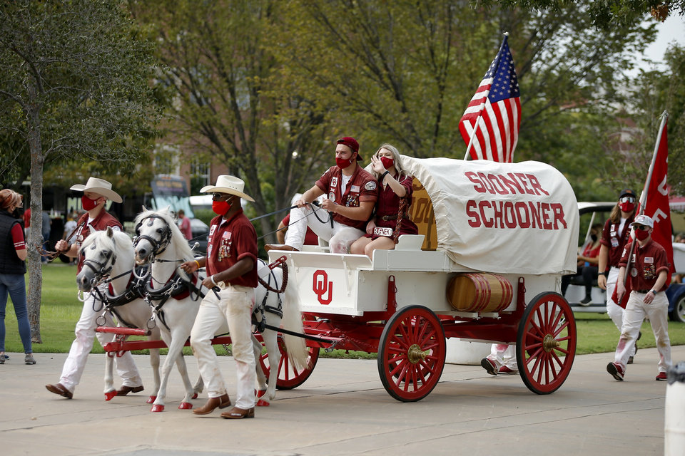Photo - The Sooner Schooner heads toward Gaylord Family-Oklahoma Memorial Stadium before a college football game between the University of Oklahoma Sooners (OU) and Missouri State in Norman, Okla., Saturday, Sept. 12, 2020. [Bryan Terry/The Oklahoman]