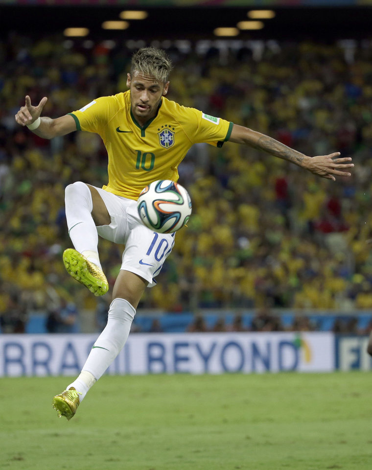 Photo - Brazil's Neymar controls the ball during the World Cup quarterfinal soccer match between Brazil and Colombia at the Arena Castelao in Fortaleza, Brazil, Friday, July 4, 2014. (AP Photo/Hassan Ammar)