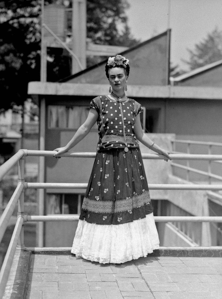 FILE - In this April 14, 1939 file photo, painter and surrealist Frida Kahlo, who was the wife of noted Mexican muralist Diego Rivera, poses at her home in Mexico City. A full collection from Kahlo's wardrobe will go on public display Nov. 22 in Mexico City after being locked for nearly 50 years in her armoires and dressers: jewelry, shoes and clothes that still carry the scent of the late artist's perfume and cigarette smoke or stains from painting. (AP Photo/File)