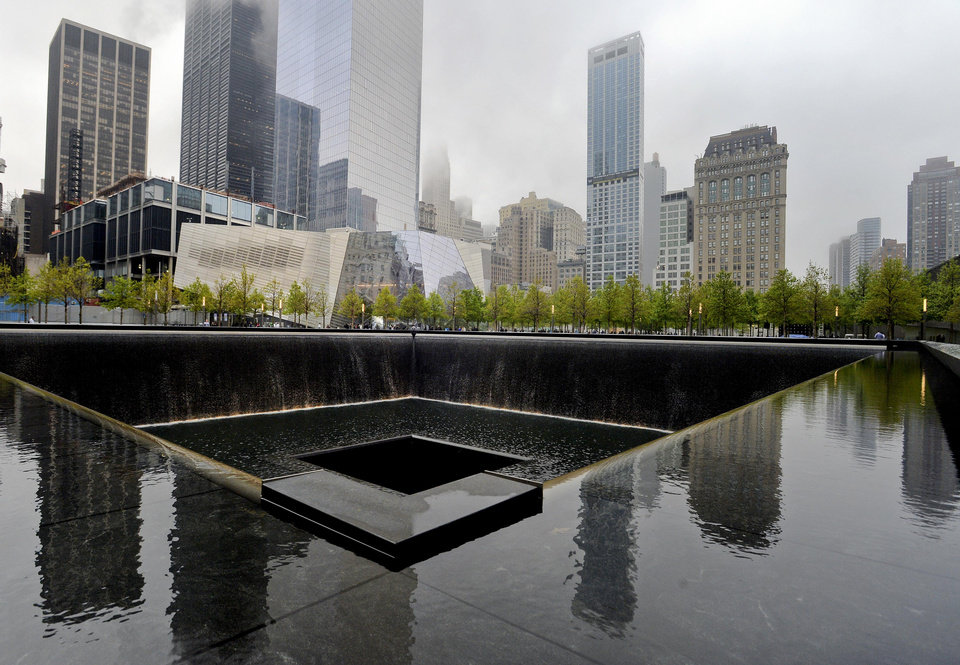 Photo - A view of the National September 11 Memorial Museum with the north reflecting pool in foreground during the museum's dedication ceremony in New York on Thursday, May 15, 2014.  (AP Photo/Justin Lane, Pool)
