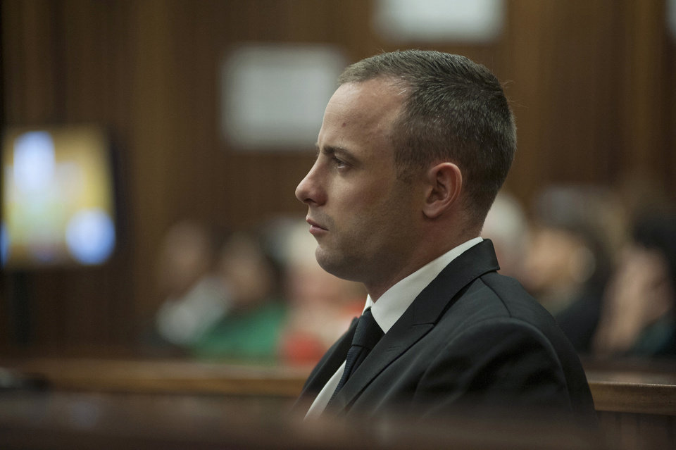 Photo - Oscar Pistorius looks straight ahead inside a courtroom at the high court in Pretoria, South Africa, Monday May 5, 2014 at the resumption of his murder trial, following a two-week break. Pistorius' murder trial enters a critical phase Monday as his defense team attempts to recover from a faltering start and reinforce the disabled athlete's claim that he fatally shot girlfriend Reeva Steenkamp by mistake because he was overwhelmed by a long-held fear of violent crime. (AP Photo/Ihsaan Haffejee, Pool)