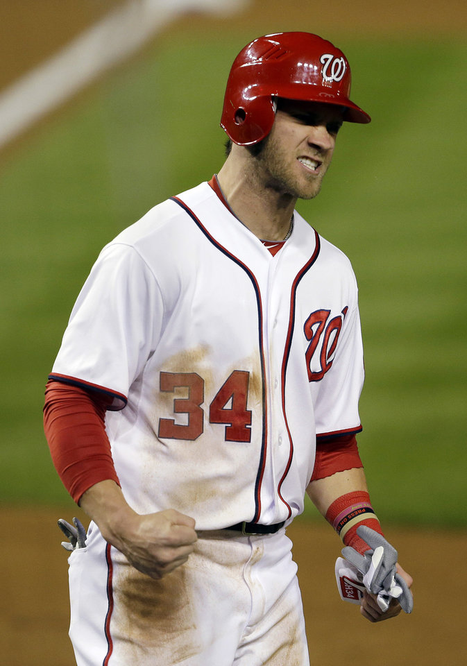 Washington Nationals' Bryce Harper reacts after scoring on a home run by Ryan Zimmerman in the first inning of Game 5 of the National League division baseball series against the St. Louis Cardinals on Friday, Oct. 12, 2012, in Washington. (AP Photo/Pablo Martinez Monsivais)