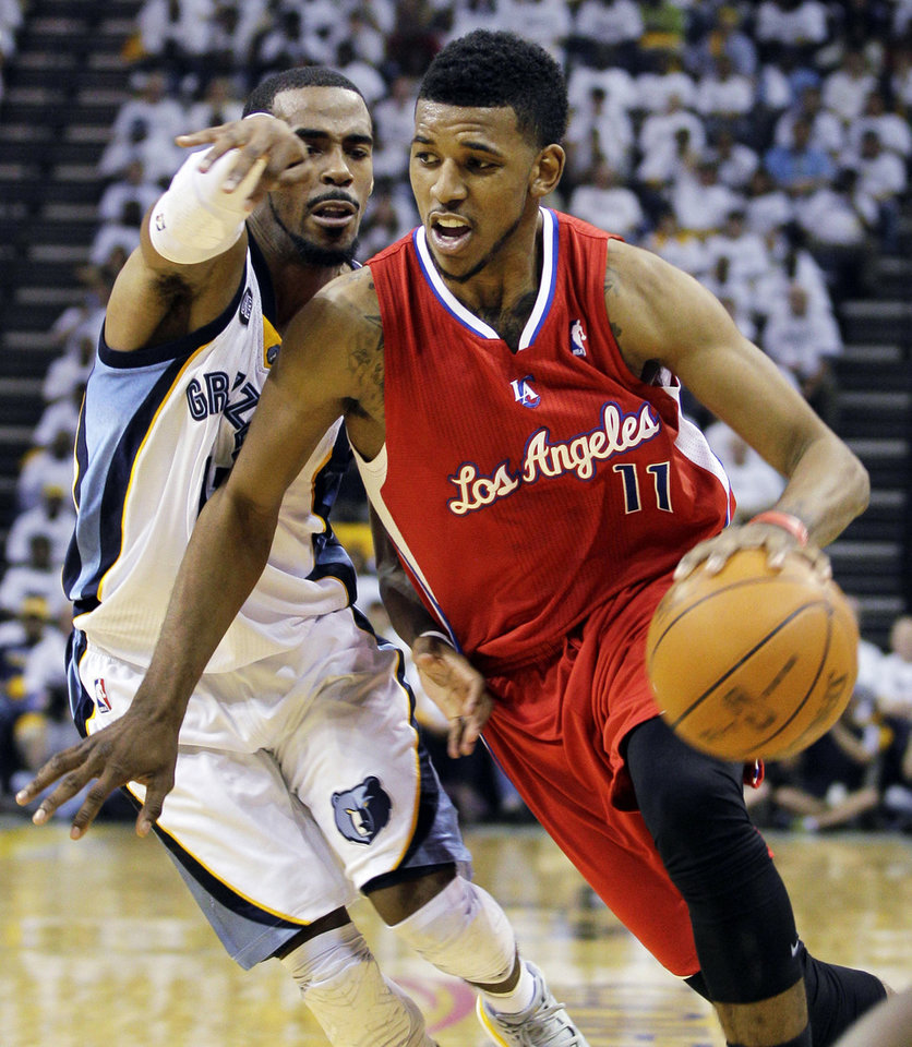 Photo -   Los Angeles Clippers' Nick Young (11) moves the ball around Memphis Grizzlies' Mike Conley during the first half in Game 1 of a first-round NBA basketball playoff series, Sunday, April 29, 2012, in Memphis, Tenn. (AP Photo/Danny Johnston)