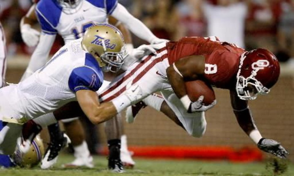 Oklahoma's Dominique Whaley (8) scores a touchdown in front of Tulsa's Trent Wilkins (1) during the college football game between the University of Oklahoma Sooners ( OU) and the Tulsa University Hurricanes (TU) at the Gaylord Family-Memorial Stadium on Saturday, Sept. 3, 2011, in Norman, Okla. Photo by Bryan Terry, The Oklahoman ORG XMIT: KOD