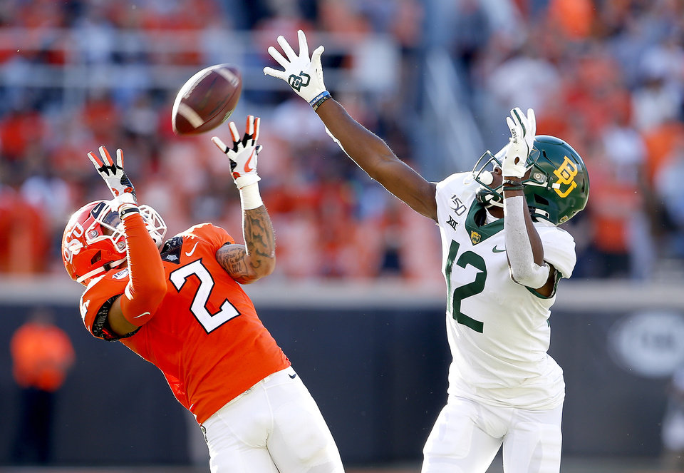 Photo - Oklahoma State's Tylan Wallace (2) makes a reception as Baylor's Kalon Barnes (12) defends in the third quarter during the college football game between Oklahoma State University and Baylor at Boone Pickens Stadium in Stillwater, Okla., Saturday, Oct. 19, 2019. Baylor won 45-27. [Sarah Phipps/The Oklahoman]