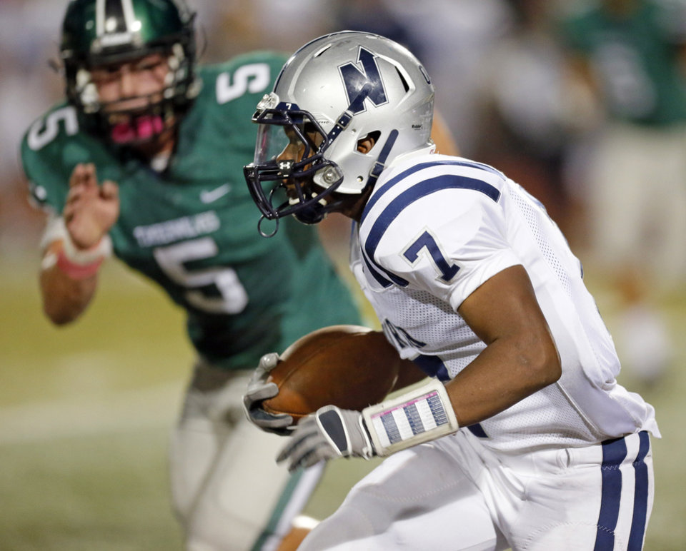 Edmond North's Marque Depp (7) runs after a catch as Norman North's Beau Proctor (5) pursues during a high school football game between Edmond North and Norman North in Norman, Okla., Thursday, Oct. 11, 2012. Photo by Nate Billings, The Oklahoman