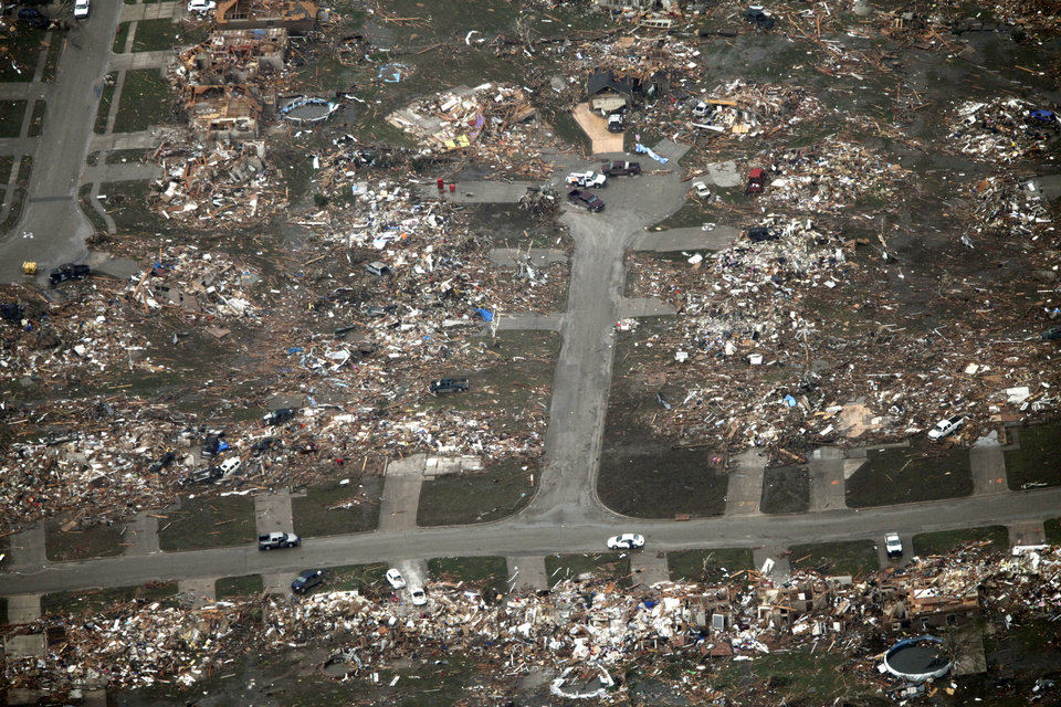 Photo - This street of houses was totally destroyed by the May 20th tornado in Moore, OK, Tuesday, May 21, 2013,  By Paul Hellstern, The Oklahoman