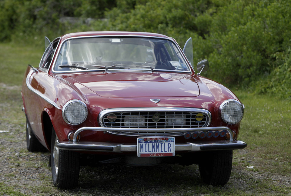 Photo -   Irv Gordon's Volvo P1800 in Babylon, N.Y., Monday, July 2, 2012. Gordon's car already holds the world record for the highest recorded milage on a car and he is less than 40,000 miles away from passing three million miles on the Volvo. (AP Photo/Seth Wenig)