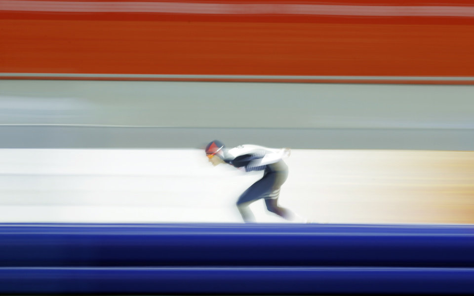 Photo - Martina Sablikova of the Czech Republic skates her way to gold in the women's 5,000-meter speedskating race at the Adler Arena Skating Center during the 2014 Winter Olympics in Sochi, Russia, Wednesday, Feb. 19, 2014. (AP Photo/Matt Dunham)