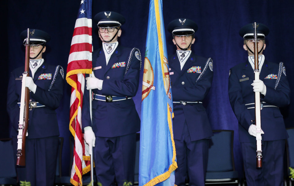 Photo - Members of the Edmond North Air Force JROTC present the colors during the ceremony for the 2020 Oklahoma Teacher of the Year in the Modern Living Building at the OKC Fairgrounds in Oklahoma City, Tuesday, Sept. 17, 2019. [Nate Billings/The Oklahoman]