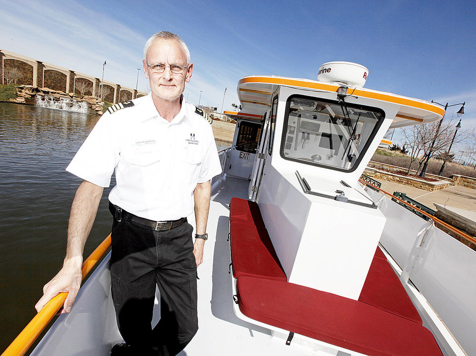 Photo - Jerry Lojka poses for a photo on the Oklahoma River boat, The Devon Explorer.