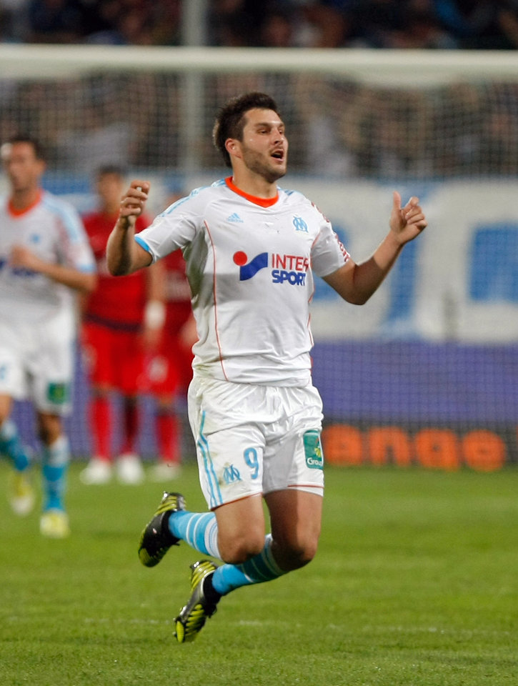 Photo -   Marseille's French forward Andre-Pierre Gignac, reacts after scoring against Paris Saint-Germain, during their League One soccer match, in Marseille, southern France, Sunday, Oct.7, 2012. (AP Photo/Claude Paris)