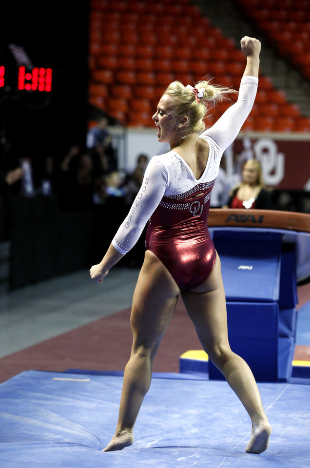Brie Olson celebrates her vault as the University of Oklahoma Sooners (OU) compete at the NCAA, Women's Gymnastics Regional at The Lloyd Noble Center on Saturday, April 6, 2013  in Norman, Okla. Photo by Steve Sisney, The Oklahoman