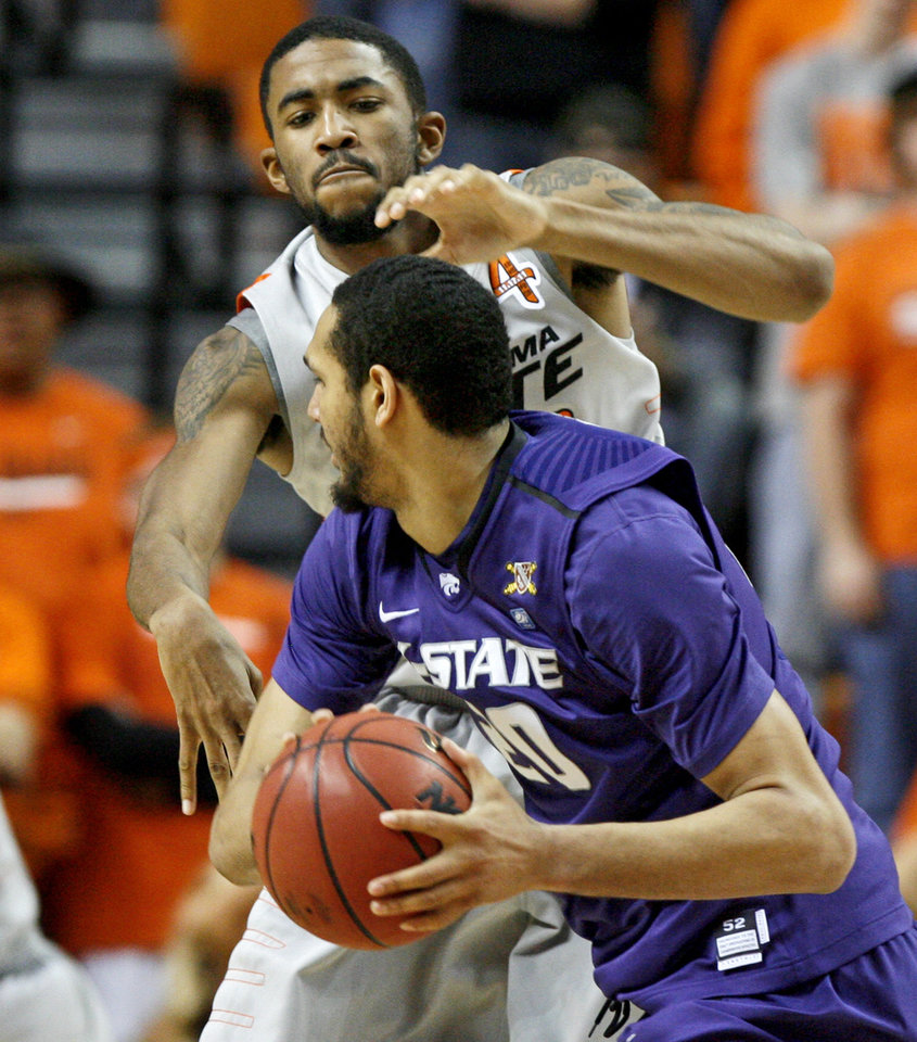 Photo - Oklahoma State's Michael Cobbins (20) defends Kansas State's Adrian Diaz (20) during an NCAA college basketball game between the Oklahoma State University Cowboys (OSU) and the Kansas State University Wildcats (KSU) at Gallagher-Iba Arena in Stillwater, Okla., Saturday, Jan. 21, 2012. Photo by Bryan Terry, The Oklahoman