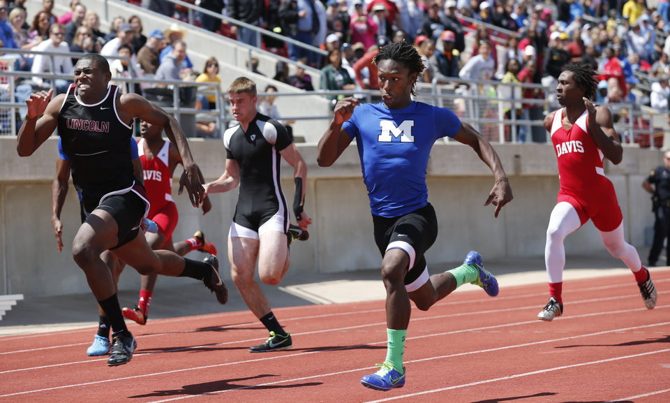 Millwood's Janari Glover wins the Boys 3A 100 Meter Dash and Lincoln Christian's Anthony Wilkinson is second during the State 3A and 4A Track Meet on Saturday, May 4, 2013, in Ardmore, Okla.   Photo by Steve Sisney, The Oklahoman