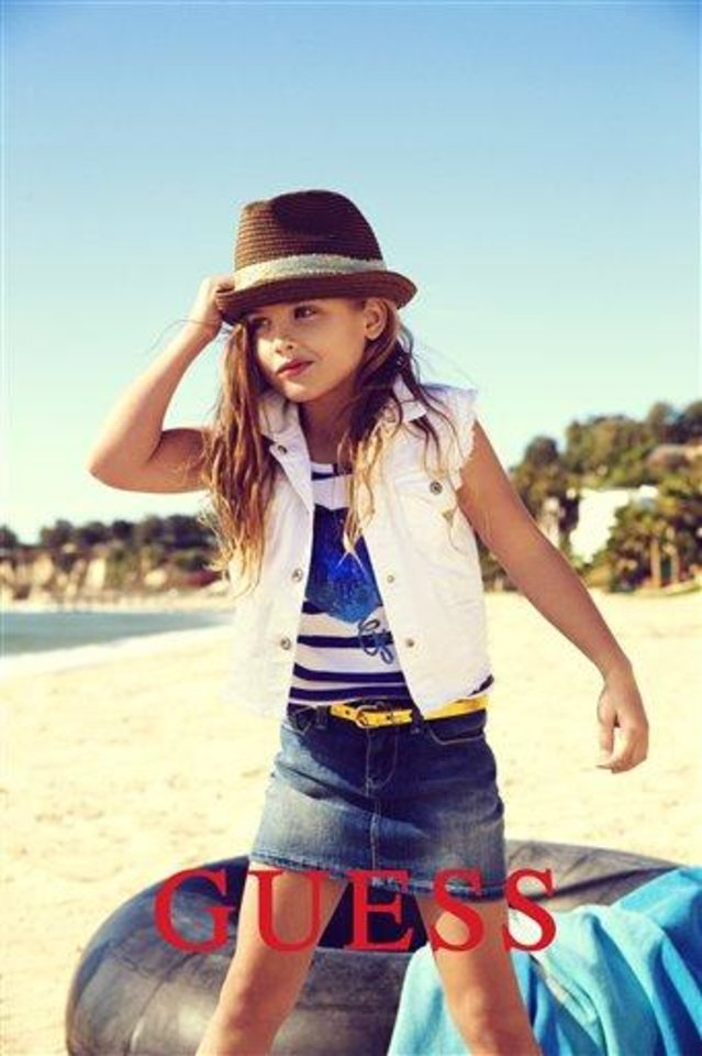 This campaign ad image provided by Guess? Inc., shows 6-year-old Dannielynn Birkhead. Birkhead, the daughter of the late Anna Nicole Smith, is walking in her mother\'s shoes, taking a starring role in the spring ad campaign for Guess Kids. (AP Photo/Guess? Inc.)