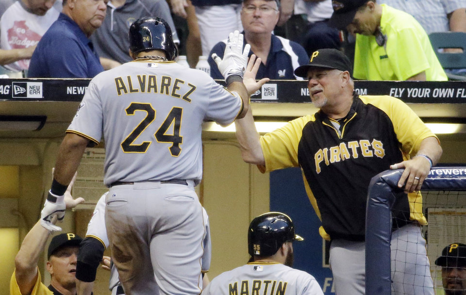 Photo - Pittsburgh Pirates' Pedro Alvarez is congratulated by manager Clint Hurdle after Alvarez hit a three-run home run during the fourth inning of a baseball game against the Milwaukee Brewers on Saturday, Aug. 23, 2014, in Milwaukee. (AP Photo/Morry Gash)