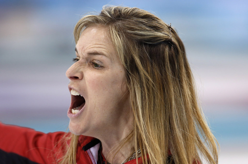 Photo - Canada's skip Jennifer Jones shouts to her sweepers during women's curling competition against Great Britain at the 2014 Winter Olympics, Wednesday, Feb. 12, 2014, in Sochi, Russia. (AP Photo/Robert F. Bukaty)