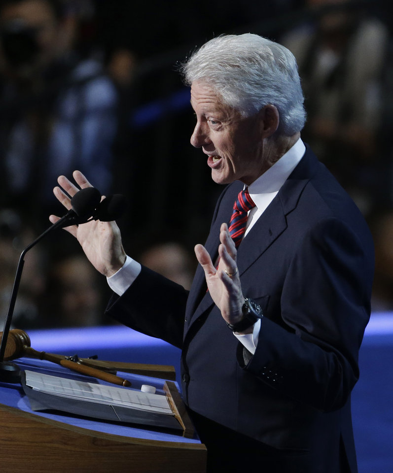 Photo - Former President Bill Clinton speaks to delegates at the Democratic National Convention in Charlotte, N.C., on Wednesday, Sept. 5, 2012. (AP Photo/Lynne Sladky)  ORG XMIT: DNC187