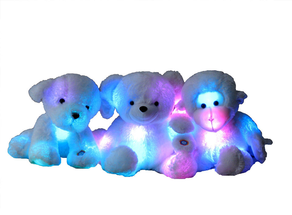 Photo - TOY: Glo-E Plush Animals - stuffed monkeys, puppies or teddy bears with seven-color shifting light shows inside.  ORG XMIT: 0811201802561745
