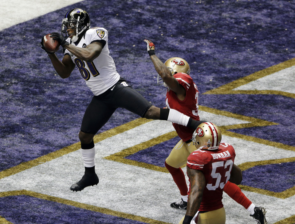 Photo - FILE - In this Feb. 3, 2013, file photo, Baltimore Ravens wide receiver Anquan Boldin (81) catches a 13-yard pass for a touchdown as San Francisco 49ers linebacker NaVorro Bowman (53) trails the play during the first half of the NFL Super Bowl XLVII football game in New Orleans. The Ravens announced on Monday, March 11, that the 49ers have acquired Boldin for a sixth-round draft pick. (AP Photo/Charlie Riedel, File)