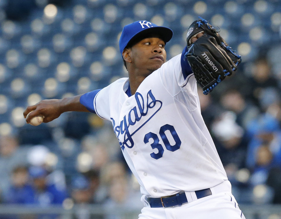 Photo - Kansas City Royals starting pitcher Yordano Ventura delivers to a Tampa Bay Rays batter during the first inning of a baseball game at Kauffman Stadium in Kansas City, Mo., Tuesday, April 8, 2014. (AP Photo/Orlin Wagner)