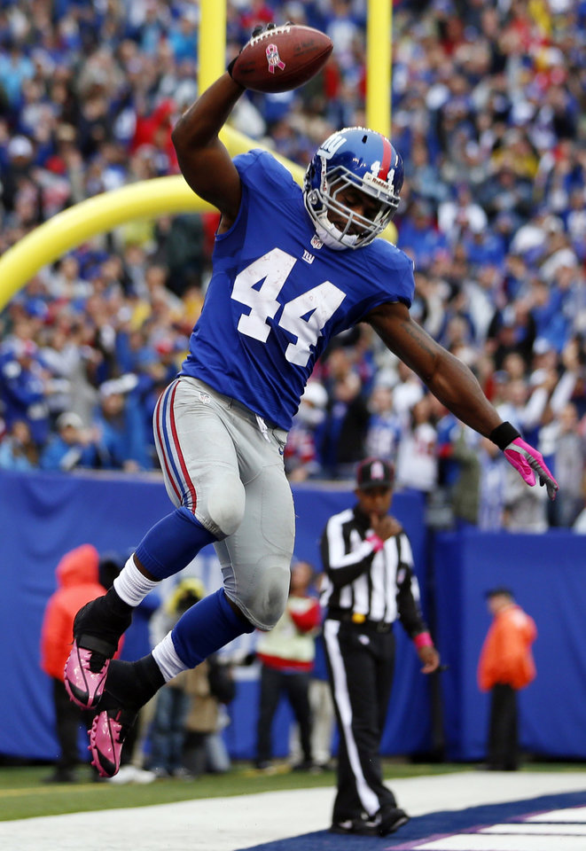 New York Giants running back Ahmad Bradshaw (44) celebrates after scoring a touchdown during the first half of an NFL football game against the Cleveland Browns, Sunday, Oct. 7, 2012, in East Rutherford, N.J. (AP Photo/Julio Cortez)