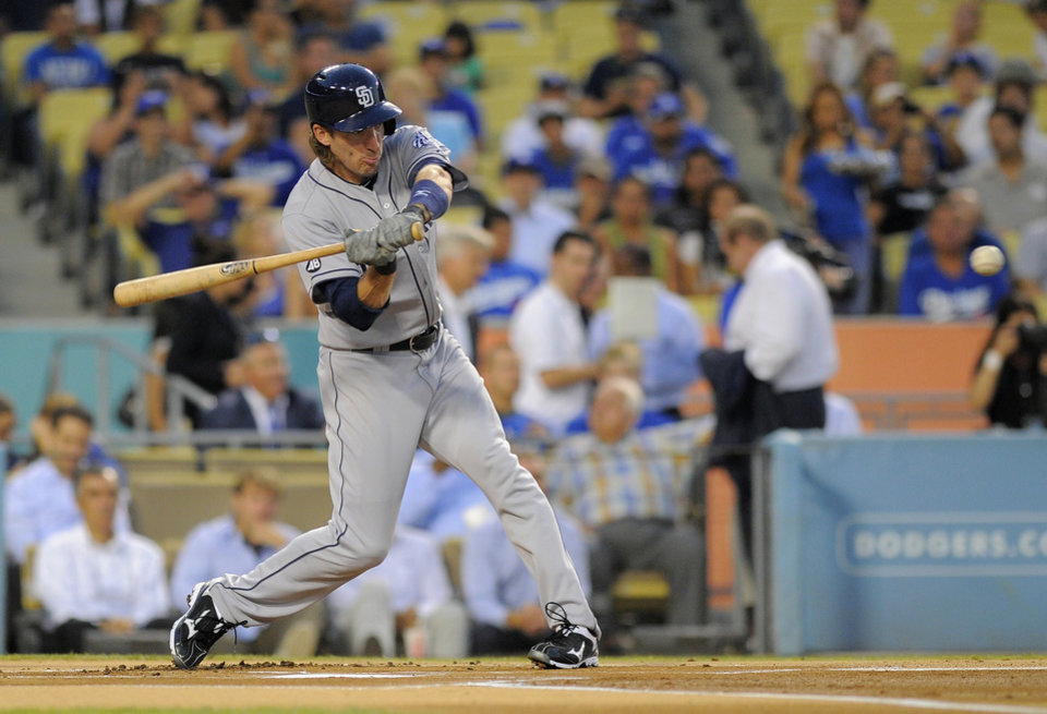 Photo -   San Diego Padres' Chris Denorfia hits the first pitch of the game for a solo home run during the first inning of their baseball game against the Los Angeles Dodgers, Tuesday, Sept. 4, 2012, in Los Angeles. (AP Photo/Mark J. Terrill)