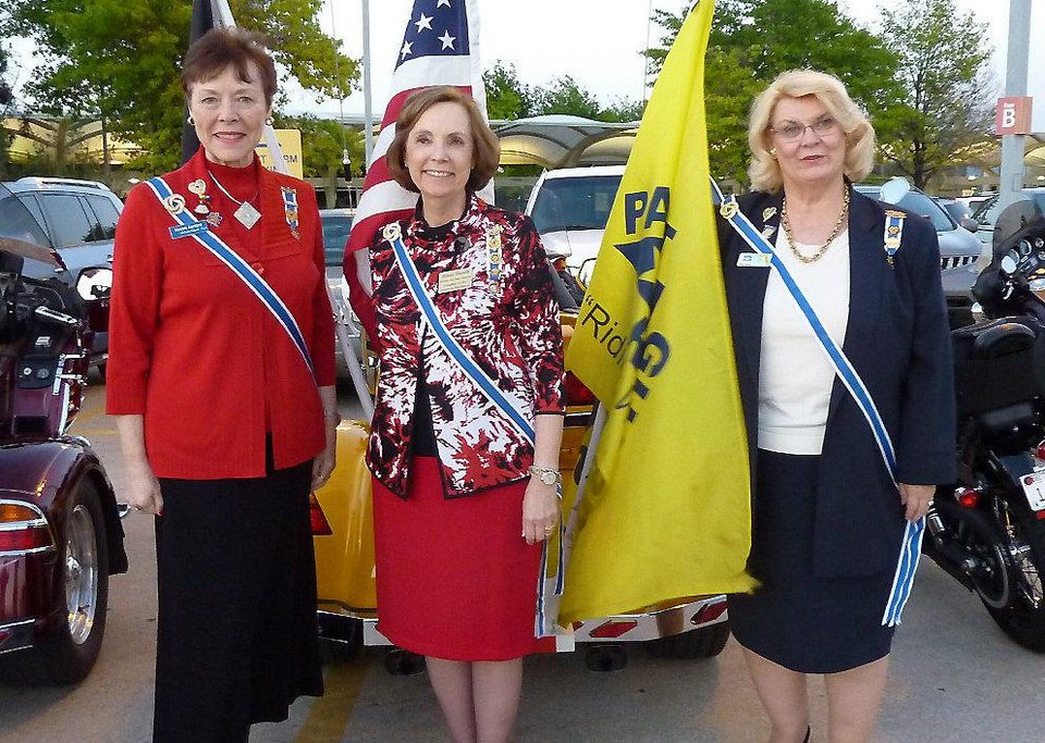 Photo - Karon Jarrad, California State Regent; Diane Hamill, Oklahoma State Regent; and Donna Cullen, Florida State Regent, were at the Tulsa International Airport to meet the Honor Flight, which was returning the war veterans that were taken to Washington, D.C., to visit the memorials.