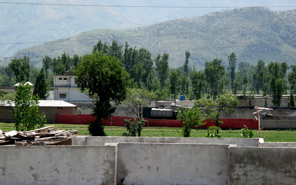Photo - The area of a compound where it is believed al-Qaida leader Osama bin Laden lived seen in Abbottabad, Pakistan on Monday, May 2, 2011. Bin Laden, the glowering mastermind behind the Sept. 11, 2001, terror attacks that killed thousands of people, was slain in his hideout in Pakistan early Monday in a firefight with U.S. forces, ending a manhunt that spanned a frustrating decade. (AP Photo/Anjum Naveed)