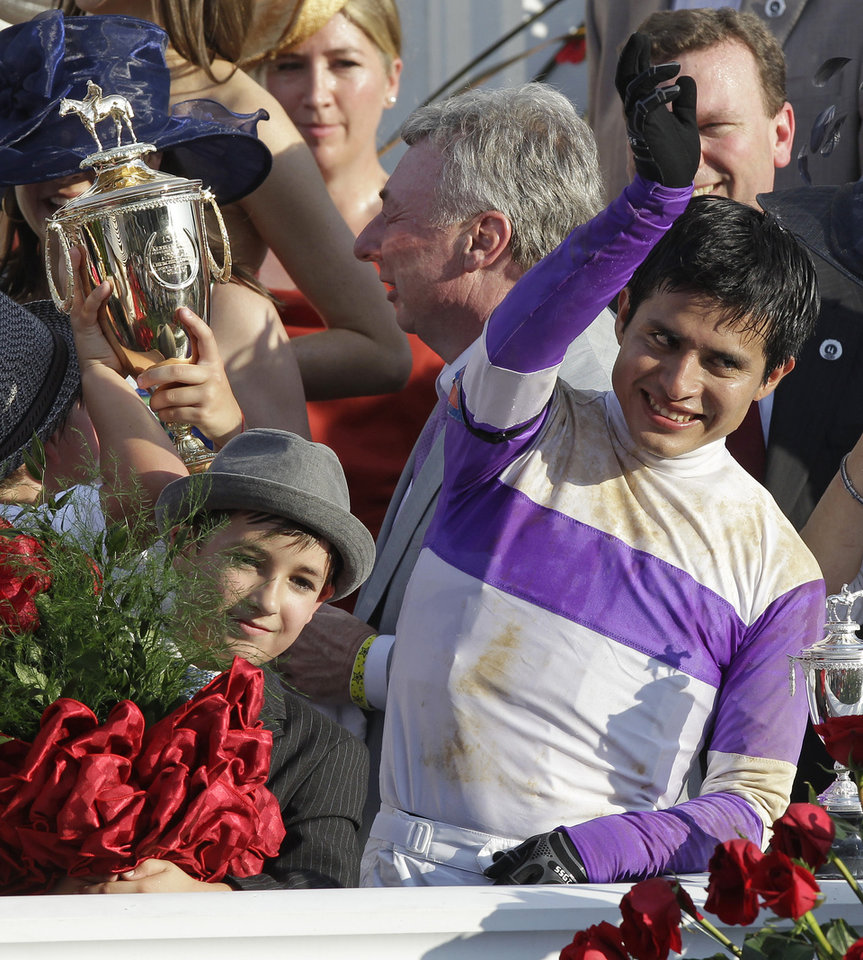 Photo - Jockey Mario Gutierrez reacts after riding  I'll Have Another to victory in the 138th Kentucky Derby horse race at Churchill Downs Saturday, May 5, 2012, in Louisville, Ky. (AP Photo/Michael Conroy) ORG XMIT: DBY220