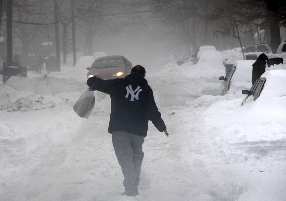 A man walks on an unplowed street in Ronkonkoma, N.Y. on Monday, Feb. 11, 2013. (AP Photo/Newsday, James Carbone) NYC LOCALS OUT