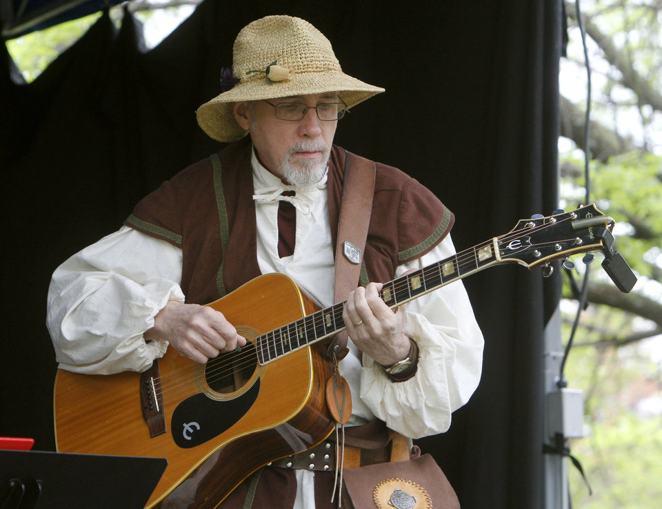 "Lee Agnew, with the musical group ""Emerald Flame"" plays guitar during the Iron Thistle Scottish Heritage Festival in Yukon, OK, Saturday, April 27, 2013,  By Paul Hellstern, The Oklahoman"