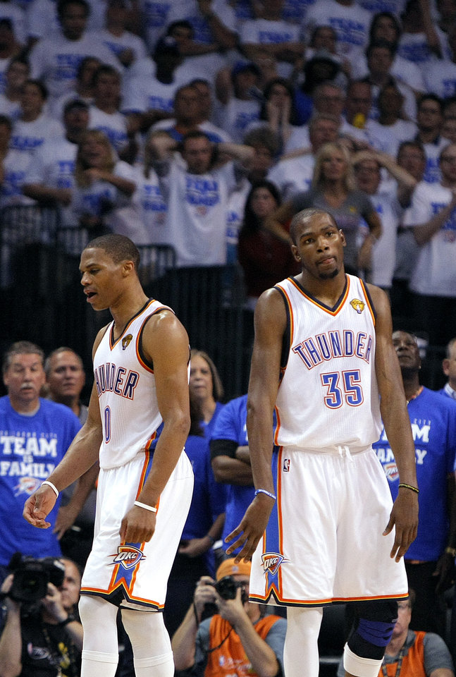 Oklahoma City's Kevin Durant (35) and Russell Westbrook (0) react in the final seconds of Game 2 of the NBA Finals between the Oklahoma City Thunder and the Miami Heat at Chesapeake Energy Arena in Oklahoma City, Thursday, June 14, 2012. Photo by Sarah Phipps, The Oklahoman