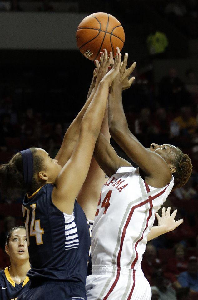 Photo - Oklahoma's Sharane Campbell fights UCO's Krystal Fowler for a rebound during the college women's basketball game between the University of Oklahoma and University of Central Oklahoma at the Lloyd Noble Center in Norman, Okla., Tuesday, Nov. 5, 2013. Photo by Sarah Phipps, The Oklahoman