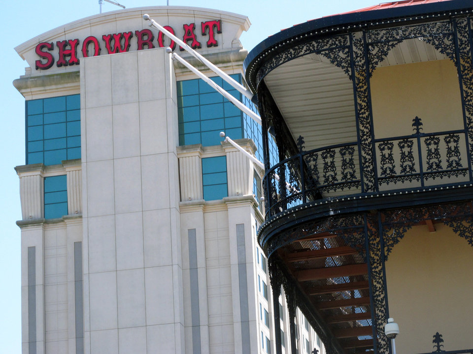 Photo - This June 27, 2014 photo shows the Showboat Casino Hotel in Atlantic City N.J., one of three Atlantic City casinos that could close by September. The closures will affect nearly 8,000 workers and their families, along with businesses that sell to the casinos, the housing market, and local and state tax collections. The rapid disintegration of Atlantic City's casino market might be an early indicator of what could happen in other parts of the country that have too many casinos and not enough gamblers. (AP Photo/Wayne Parry)