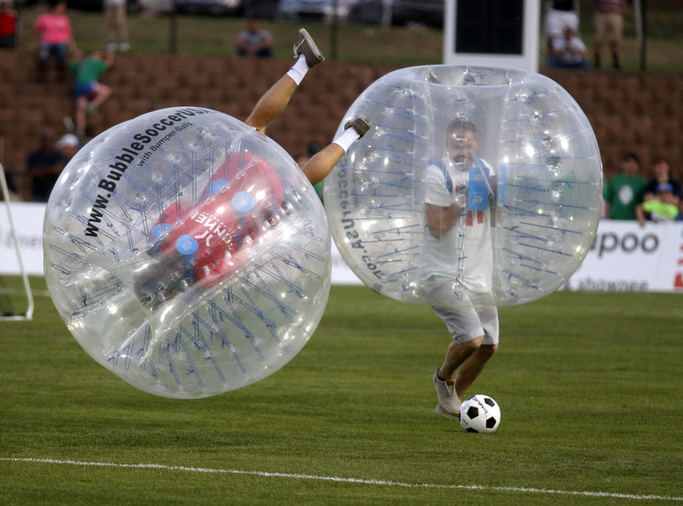 Photo - People play bubble soccer at halftime during the OKC Energy FC soccer game against Orlando City SC at Pribil Stadium in Oklahoma City, Saturday, April 26, 2014. Photo by Sarah Phipps, The Oklahoman